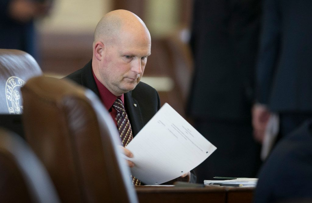 In this March 28 file photo, State Rep. Tony Tinderholt, R-Arlington, works at his desk  in the House Chamber at the Capitol. Tinderholt is one of 12 representatives that make up The Freedom Caucus.