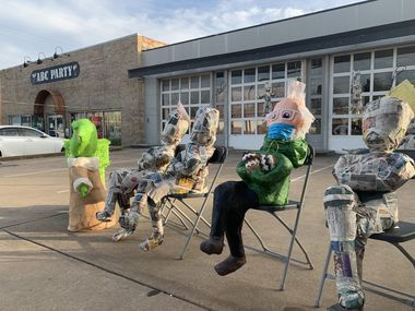 A piñata in the image of Vermont Sen. Bernie Sanders sits outside ABC Party in Oak Cliff on Thursday, Jan. 28, 2021. Carlos De La Fuente came up with the idea for the piñata after he noticed images of the senator go viral online.