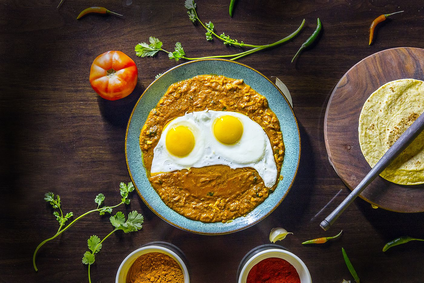 EggHolic's surti gotalo is a mixture of shredded hard boiled eggs and spices, topped with optional sunny-side up eggs.