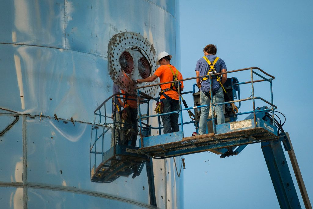 Workers make final preparations to the SpaceX a prototype of the Starship before CEO Elon Musk presented  the spacecraft at the company's SpaceX Space Launch Facility in Boca Chica, Texas, on Saturday, Sept. 28, 2019.