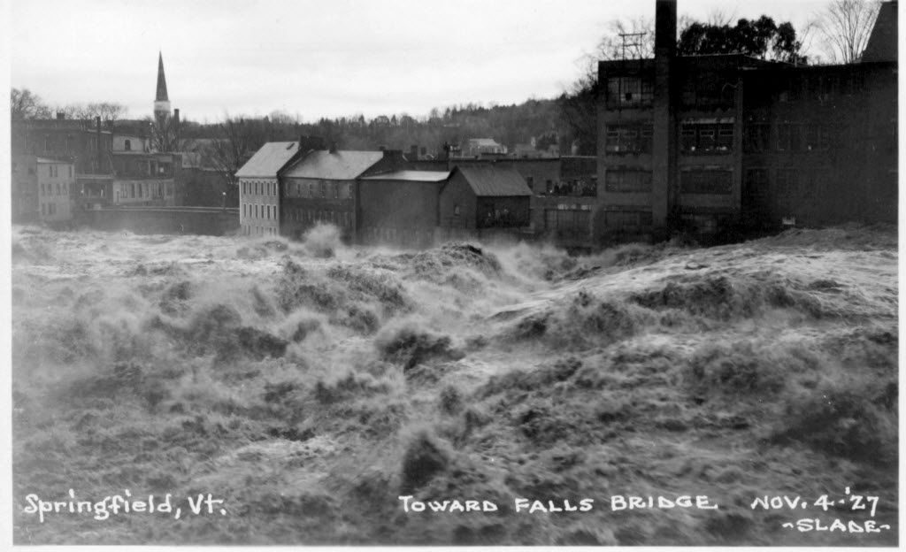 In this photo provided by the Vermont Historical Society, floodwaters rage through Springfield, Vt., in the flood of 1927. Engineers estimate that a series of flood control dams built across Vermont during the middle years of the 20th century showed their worth during flooding from Tropical Storm Irene by holding back waters that would have made flooding in certain areas significantly worse. (AP Photo)