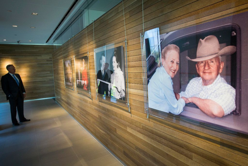 Ross Perot Jr. looks over photographs of his parents while leading a tour of the headquarters for The Perot Companies on Monday, March 20, 2017, in Dallas.