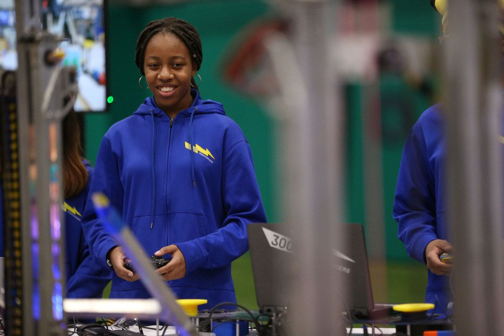 Tamrah Hughes, a sophomore at Emmett J. Conrad High School, controlled a robot during a grant announcement at the Texas Rangers MLB Youth Academy in Dallas on Friday. Dallas ISD, Toyota and SMU will combine forces to open a school in West Dallas focused on science, technology, engineering and math instruction.