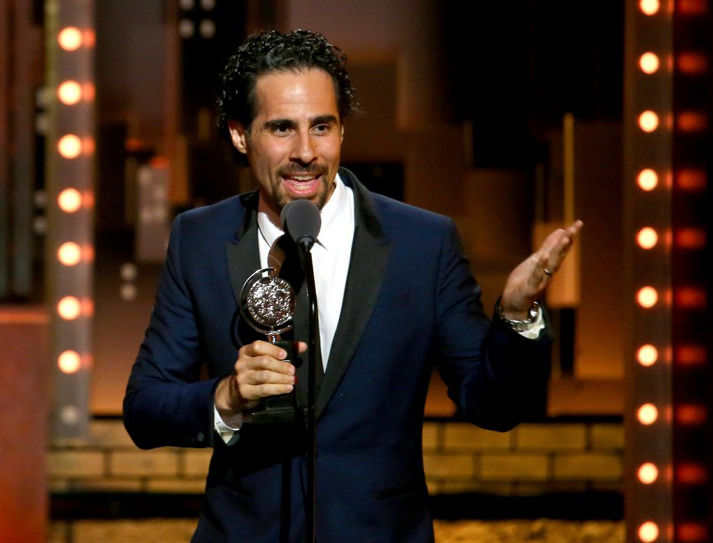"""Alex Lacamoire accepts the award for best orchestrations for """"Dear Evan Hansen"""" at the 71st annual Tony Awards on Sunday, June 11, 2017, in New York. (Photo by Michael Zorn/Invision/AP)"""