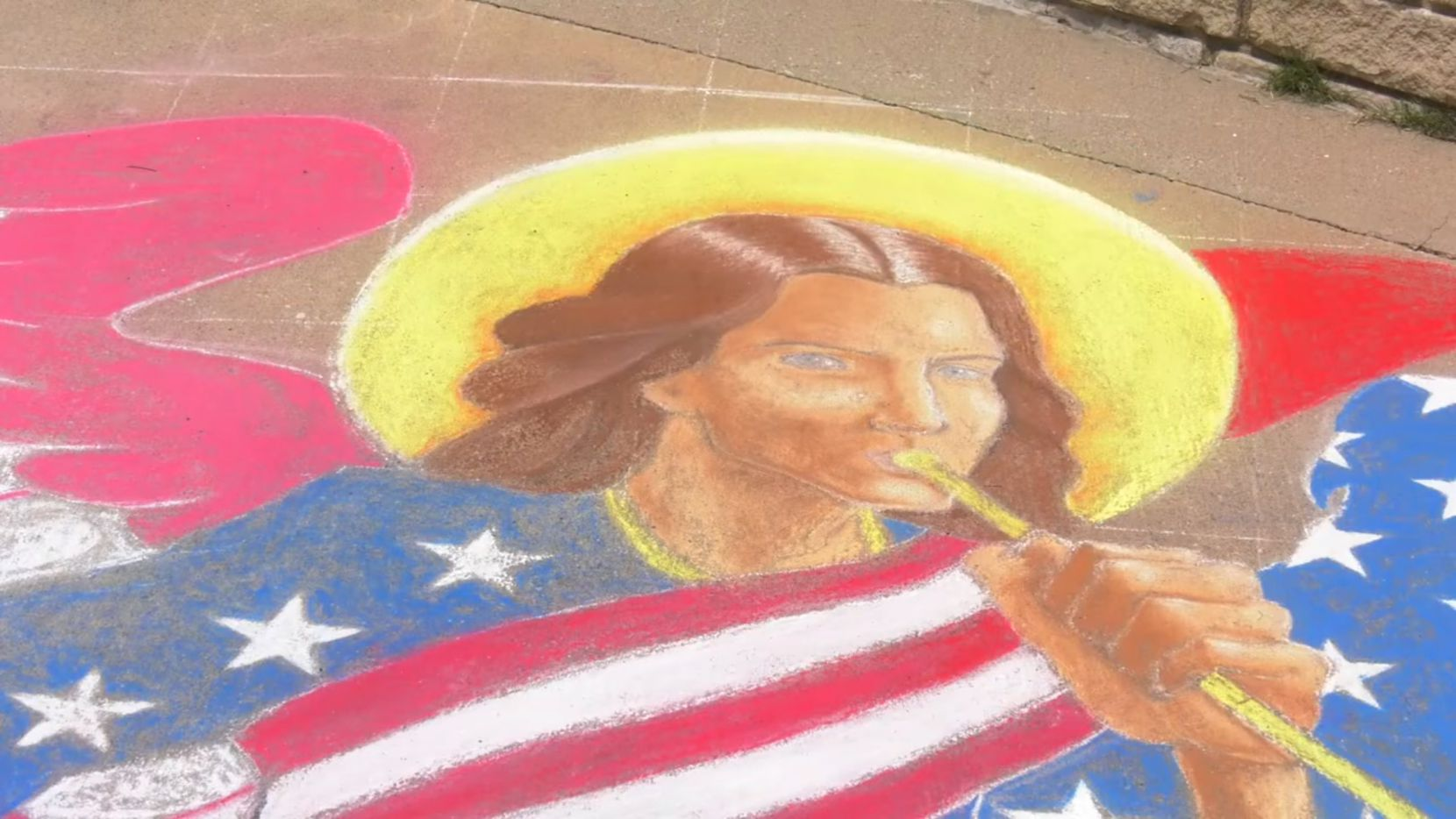 Artist Santos Lozano created a chalk mural in Memorial Park in Plano to honor the nation's military and health care workers.