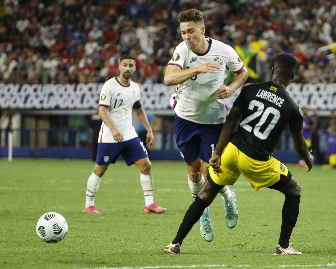 USA forward Matthew Hoppe (13) is brought down by Jamaica defender Kemar Lawrence (20) during the second half of a CONCACAF Gold Cup quarterfinal soccer match at AT&T Stadium on Sunday, July 25, 2021, in Arlington. (Elias Valverde II/The Dallas Morning News)