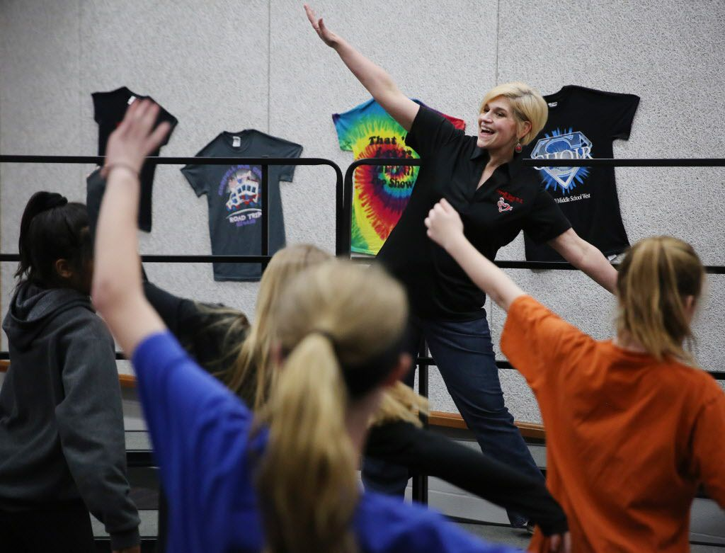 Choir teacher Allison Hartzell teaches the dance steps to a song during class at Coppell Middle School West.