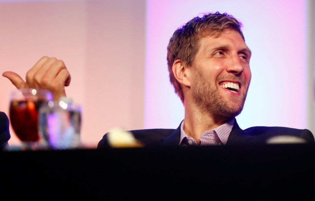 Dallas Mavericks Dirk Nowitzki laughs after former NBA player and TV analyst Charles Barkley talked about playing basketball for Auburn University in the 290 pound range during the 2017 SMU Athletic Forum at the Hilton Anatole Hotel in Dallas on Wednesday, September 20, 2017. (Vernon Bryant/The Dallas Morning News)