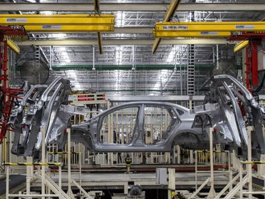 Workers assemble vehicles at a Nissan factory in Aguascalientes, Mexico.