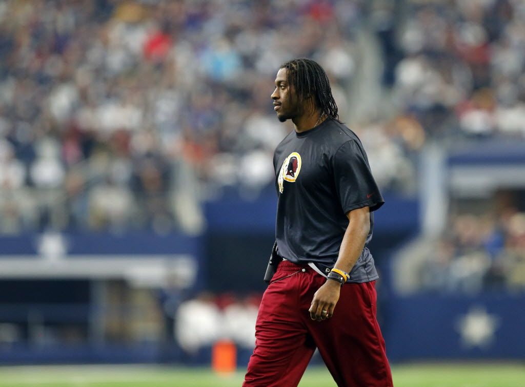 Washington Redskins quarterback Robert Griffin III as seen on the sideline against the Dallas Cowboys in the first half at AT&T Stadium in Arlington, Texas, Sunday, January 3, 2016. (Tom Fox/The Dallas Morning News)Griffin