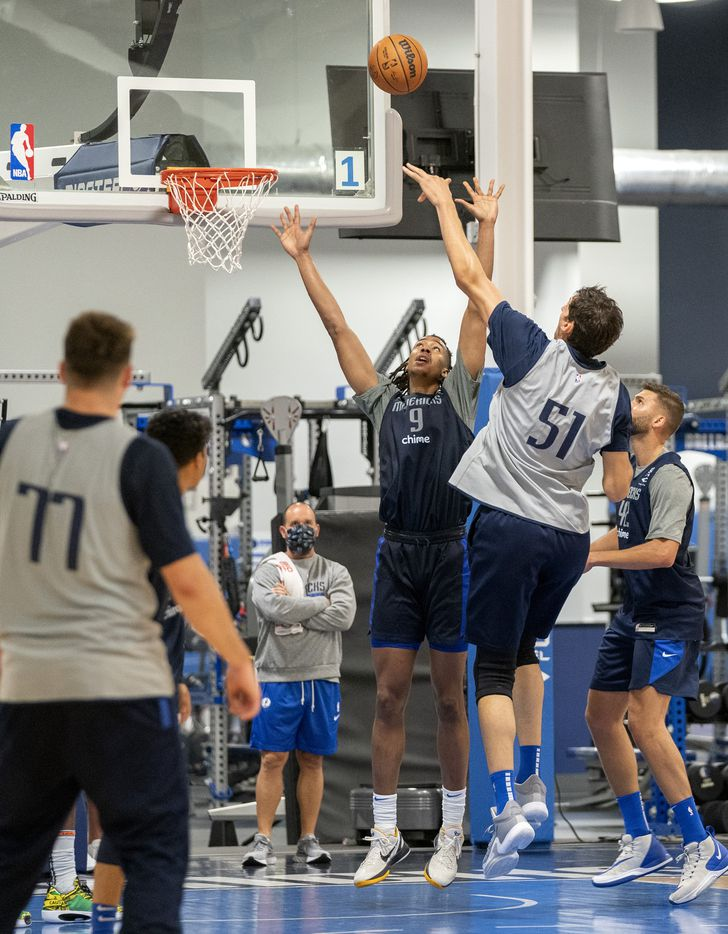 Dallas Mavericks center Moses Brown (9) tries to block the shot of center Boban Marjanović in a scrimmage during the first practice of training camp Tuesday, September 28, 2021 at the Dallas Mavericks Training Center in Dallas. (Jeffrey McWhorter/Special Contributor)