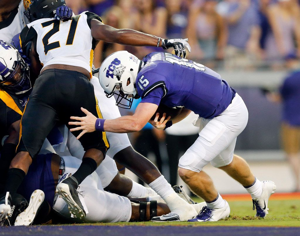 TCU Horned Frogs quarterback Max Duggan (15) ducked under Arkansas-Pine Bluff Golden Lions defensive lineman Christian Brown (27) and ran in a first quarter touchdown at Amon G. Carter Stadium in Fort Worth Texas, Saturday, August 31, 2019. (Tom Fox/The Dallas Morning News)