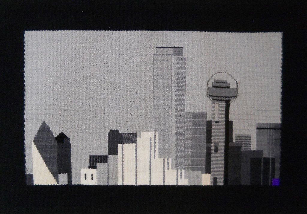 """LaDonna Mayer created this tapestry of the Dallas skyline as part of her """"51 American Cities"""" series. The collection will be on display at her Santa Fe space, Studio 17, during the New Mexico Fiber Crawl in May."""