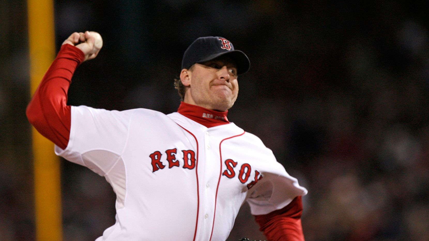 In this Oct. 25, 2007, file photo, Boston Red Sox's Curt Schilling pitches against the Colorado Rockies in Game 2 of the baseball World Series at Fenway Park in Boston. Like many baseball writers, C. Trent Rosecrans viewed the Hall of Fame vote as a labor of love. The results of the 2021 vote will be announced Tuesday, Jan. 26, 2021, and Rosecrans was not alone in finding the task particularly agonizing this time around. With Schilling's candidacy now front and center — and Barry Bonds and Roger Clemens still on the ballot as well — voters have had to consider how much a player's off-field behavior should affect his Hall of Fame chances.