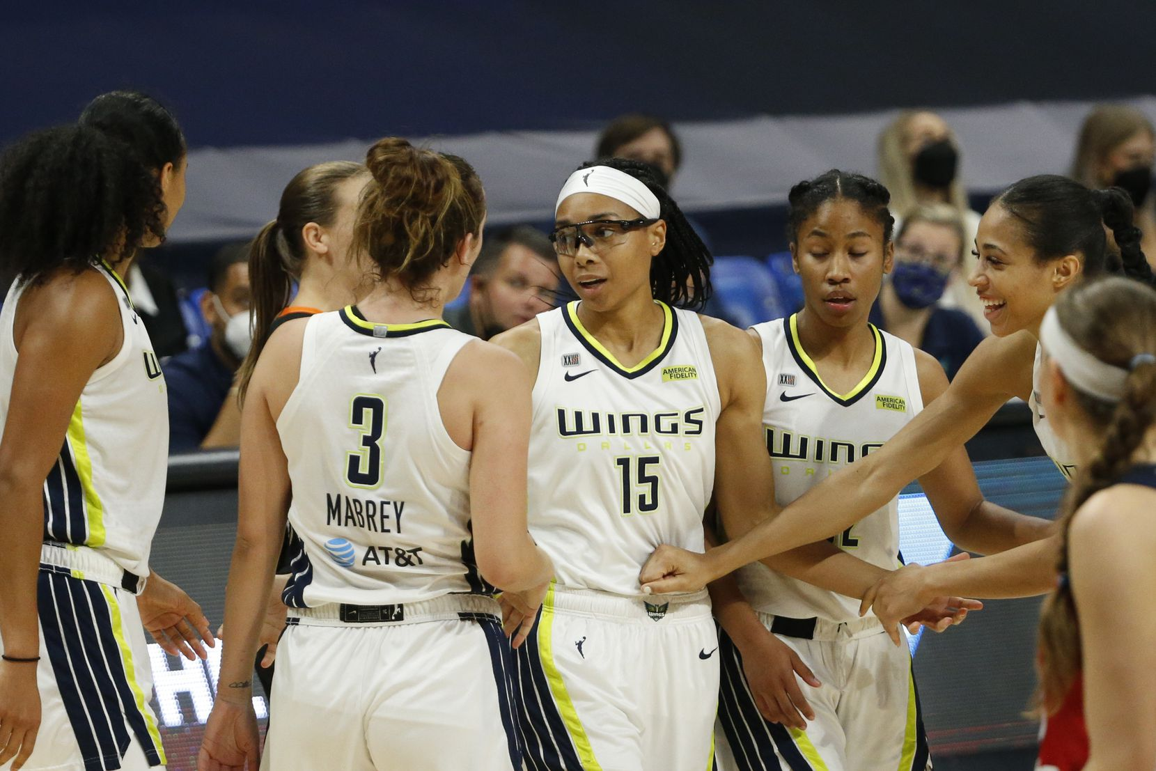Teammates celebrate Dallas Wings guard Allisha Gray (15) after a made basket and called foul during the third quarter against the Washington Mystics at College Park Center on Saturday, June 26, 2021, in Arlington. (Elias Valverde II/The Dallas Morning News)