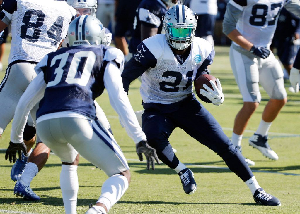 Dallas Cowboys running back Ezekiel Elliott (21) attempts to shake Dallas Cowboys cornerback Anthony Brown (30) on a run play during the afternoon practice at training camp in Oxnard, California on Wednesday, July 26, 2017. (Vernon Bryant/The Dallas Morning News)