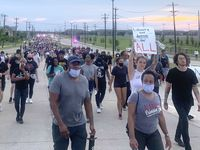 Some of the protesters who marched several miles on Eldorado Parkway in Frisco Monday.