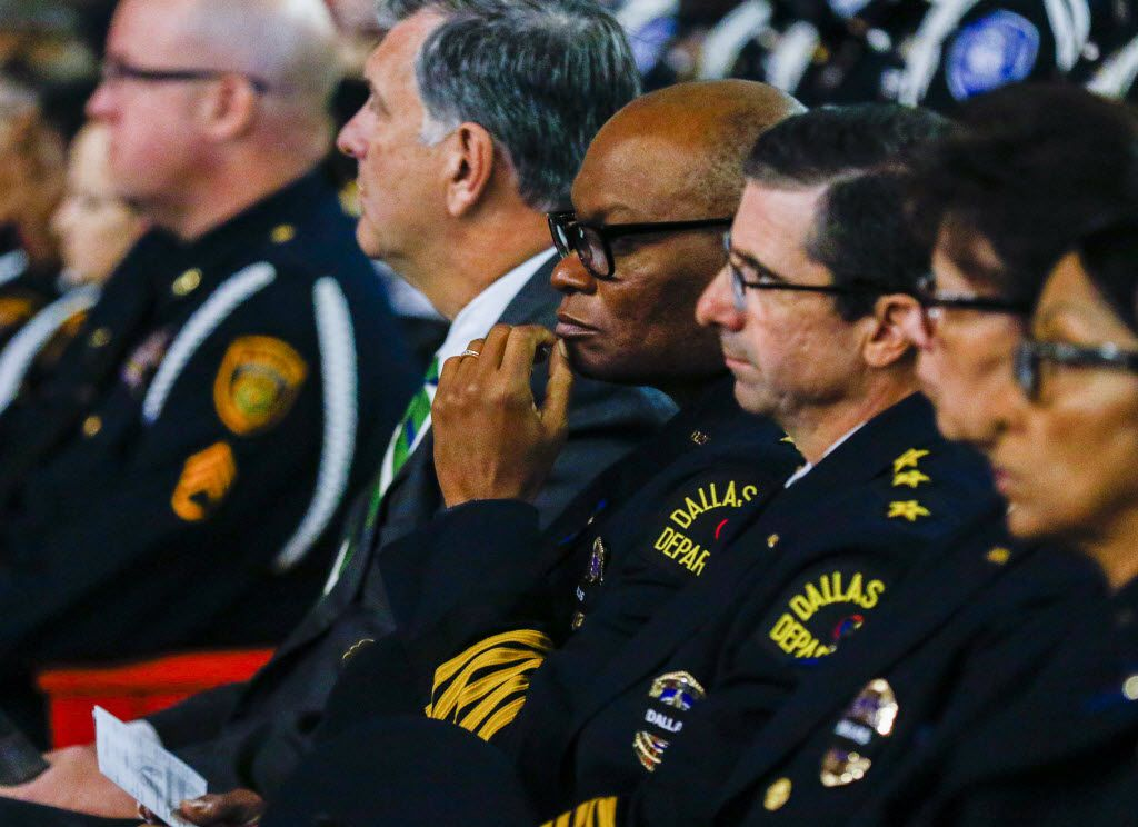 Dallas police Chief David Brown (center) attends the funeral of Officer Patrick Zamarripa, one of five officers killed in the July 7 ambush.