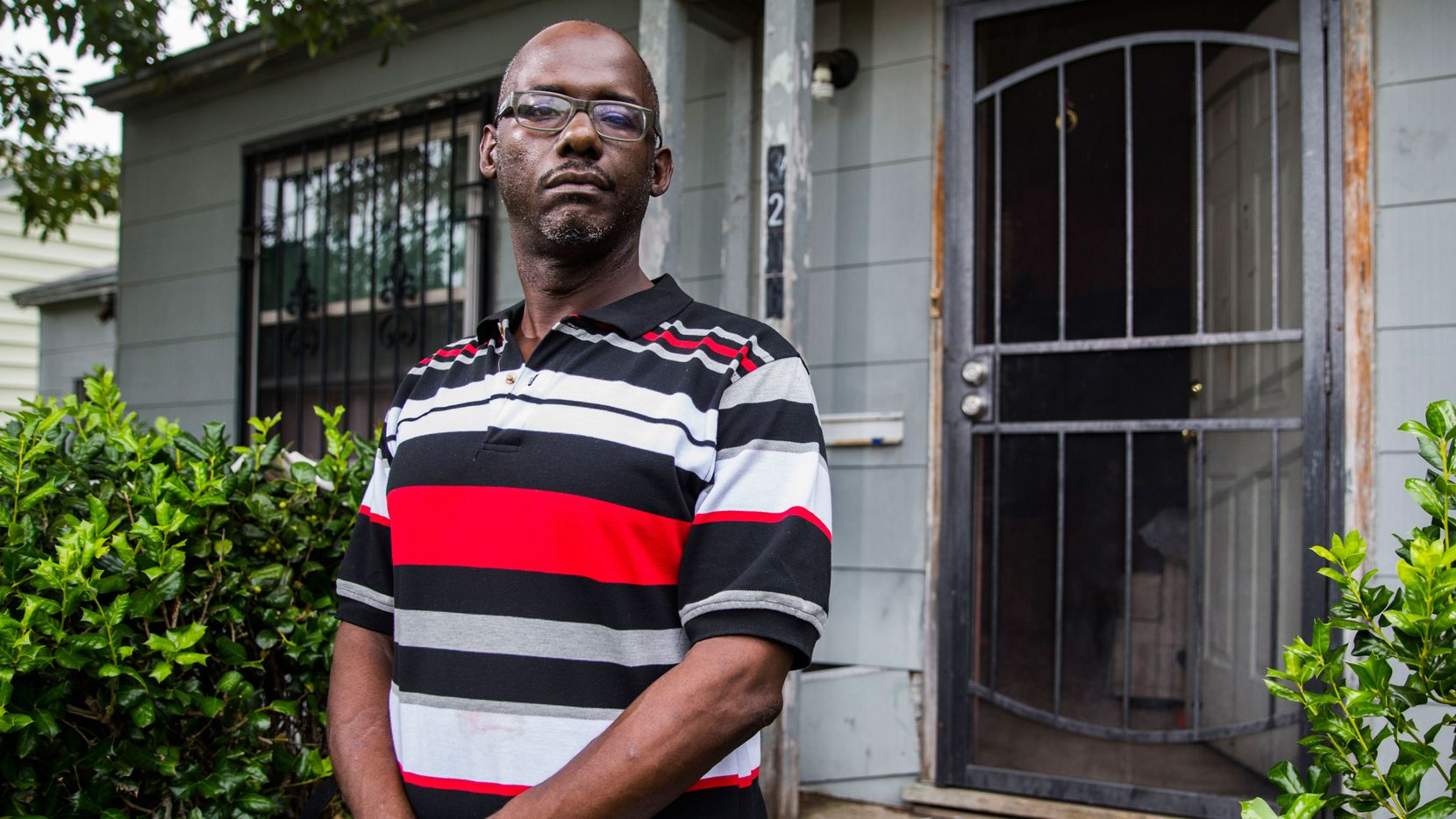Edward Adkins poses for a portrait outside his home on Tuesday, August 16, 2016 on Arizona Ave in Dallas. Adkins owes $420 for a bicycle helmet ticket.