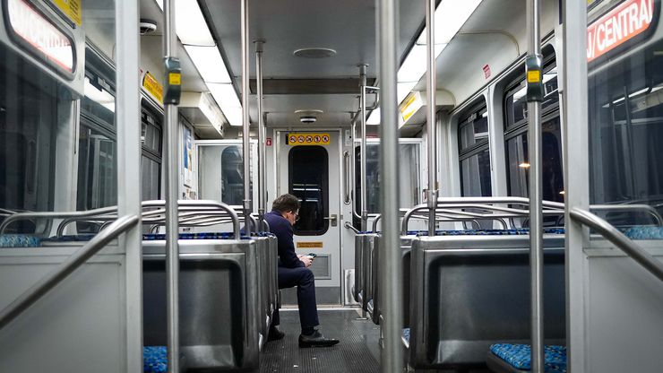 A lone passenger has a car to himself on the DART Orange Line near the North Lake College station at around 8:00 p.m. on Friday, March 20, 2020, in Irving.