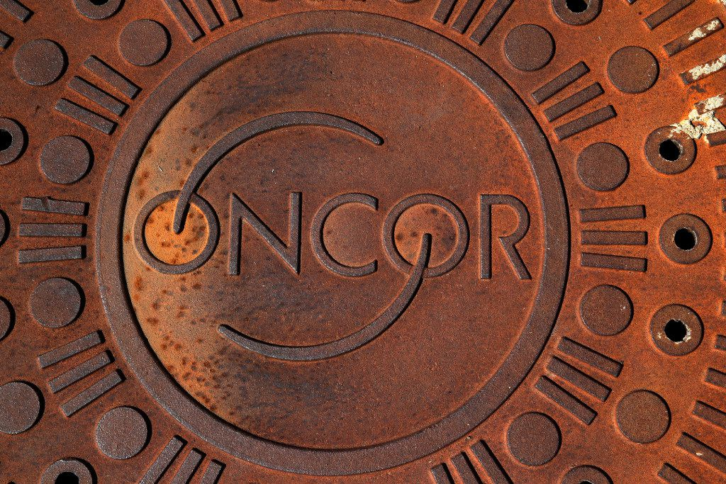 An Oncor sewer manhole cover next to Katy Trail in Dallas on April 8, 2017.