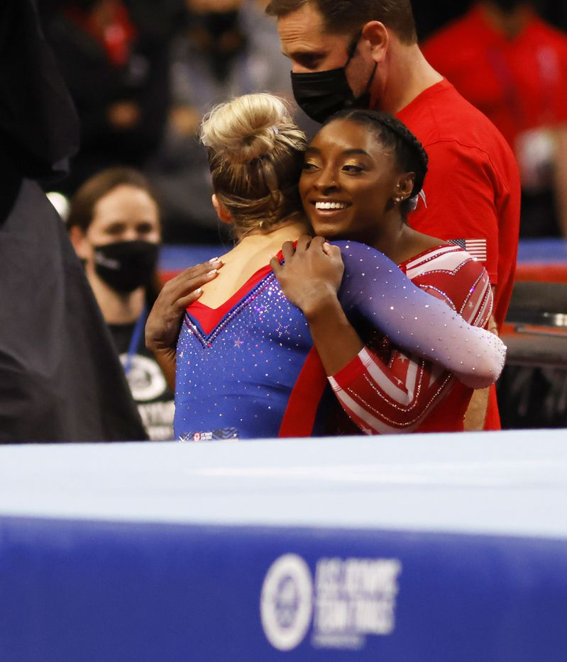 Simone Biles hugs MyKayla Skinner after completing her floor routine during day 2 of the women's 2021 U.S. Olympic Trials at The Dome at America's Center on Saturday, June 27, 2021 in St Louis, Missouri.(Vernon Bryant/The Dallas Morning News)