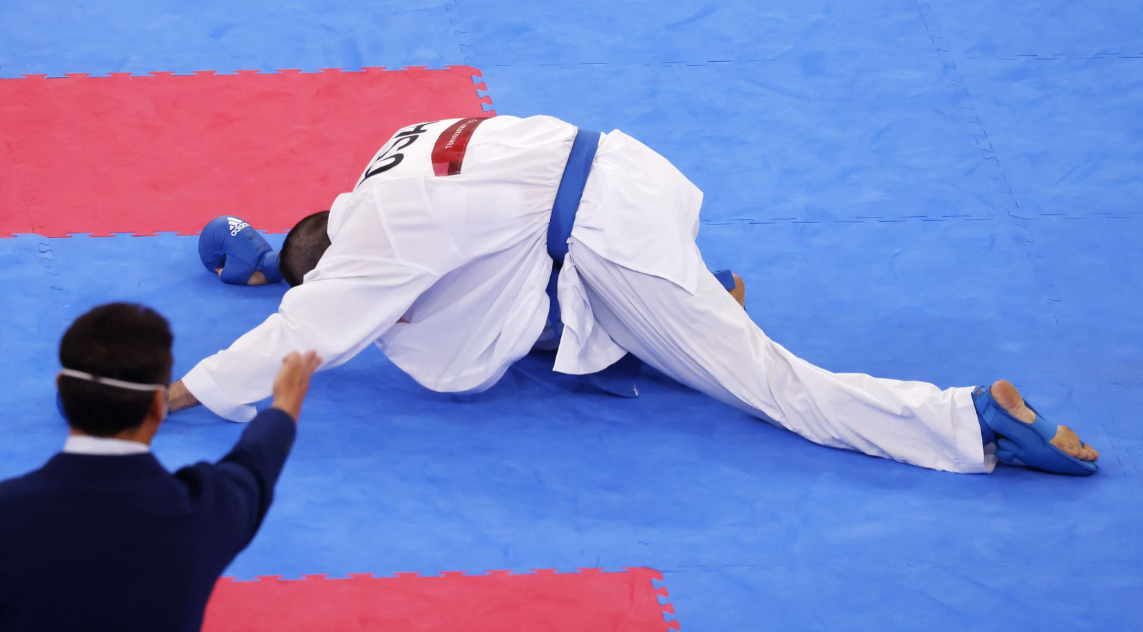USA's Tom Scott takes minute to get up after getting hit in the head by Egypt's Abdalla Abdelaziz during the karate men's kumite -75kg elimination round at the postponed 2020 Tokyo Olympics at Nippon Budokan, on Friday, August 6, 2021, in Tokyo, Japan. Scott defeated Abdelaziz 7-6. Scott finished in fourth place in his pool and did not advance to the next round. (Vernon Bryant/The Dallas Morning News)
