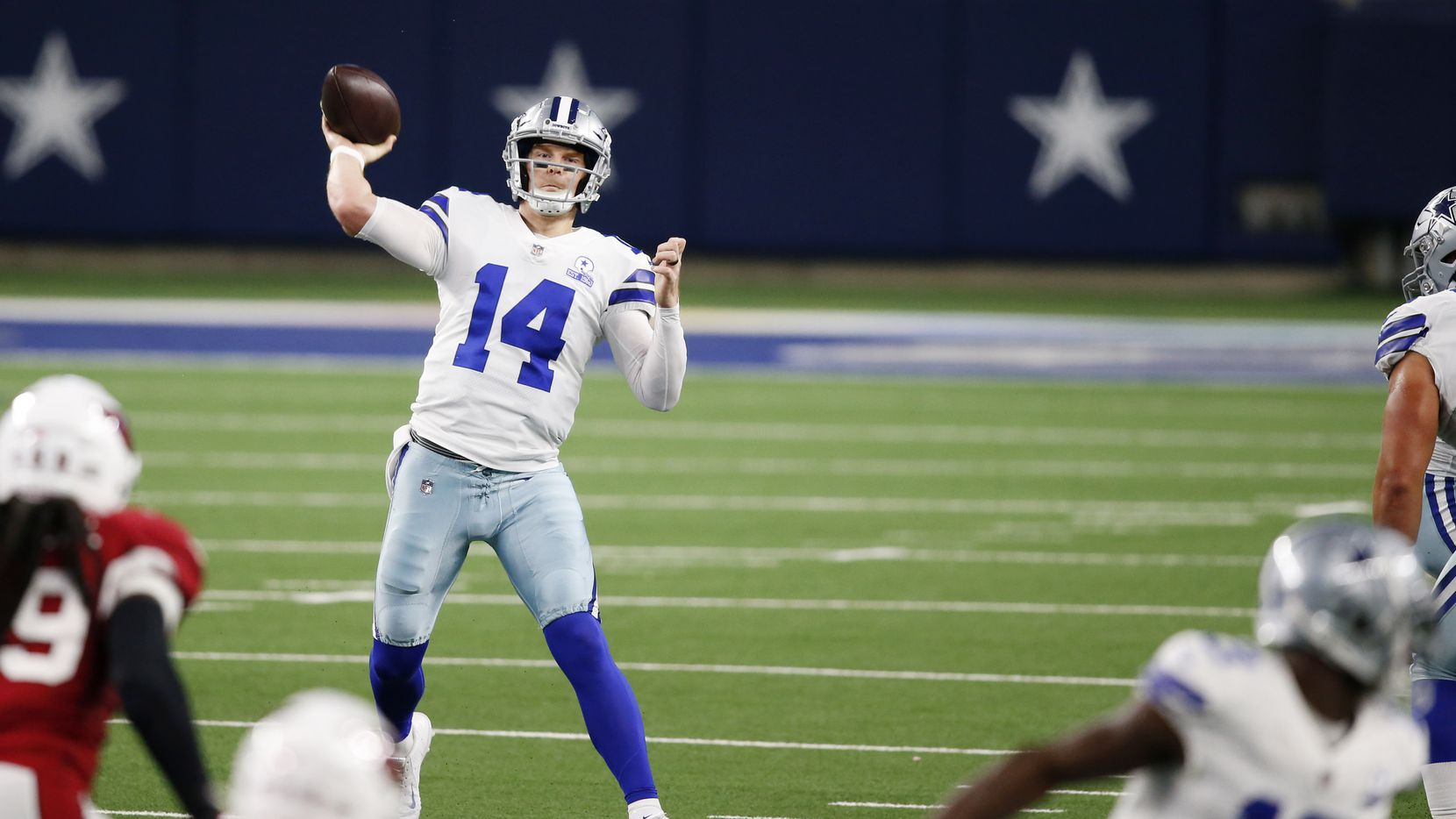 Dallas Cowboys quarterback Andy Dalton (14) attempts a pass in a game against the Arizona Cardinals during the second quarter of play at AT&T Stadium on Monday, October 19, 2020 in Arlington, Texas.