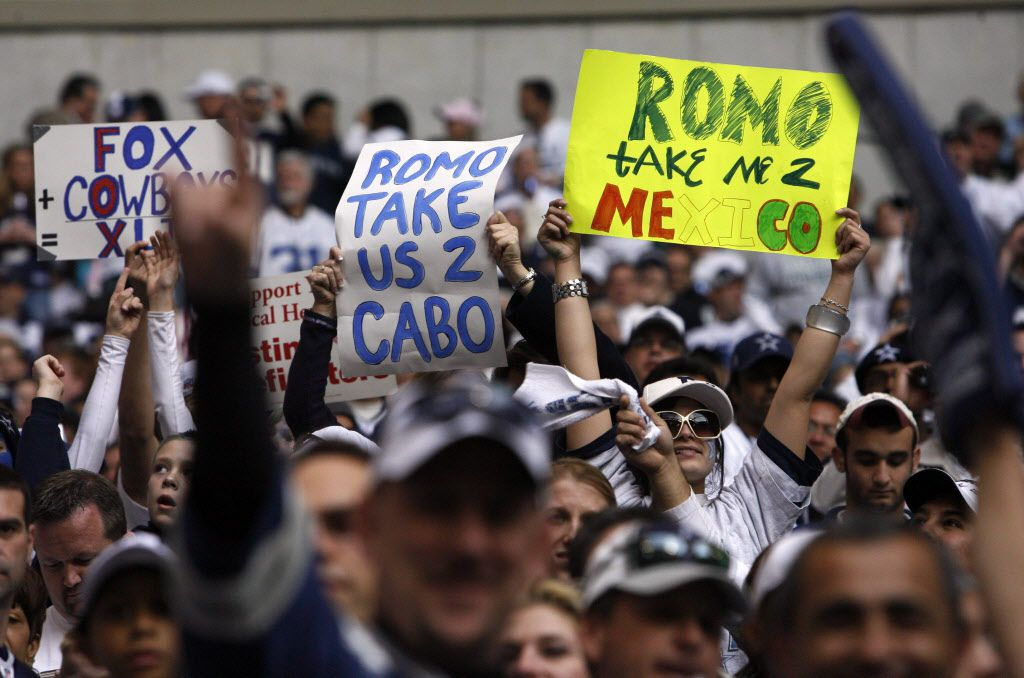 Fans hold signs supporting Tony Romo's bye-week trip to Mexico during the Cowboys' divisional-round playoff game against the New York Giants on Jan. 13, 2008, at Texas Stadium in Irving. The Cowboys, who had won the NFC East with a 13-3 record, fell to the Giants, who had made the playoffs as a wild card at 10-6.