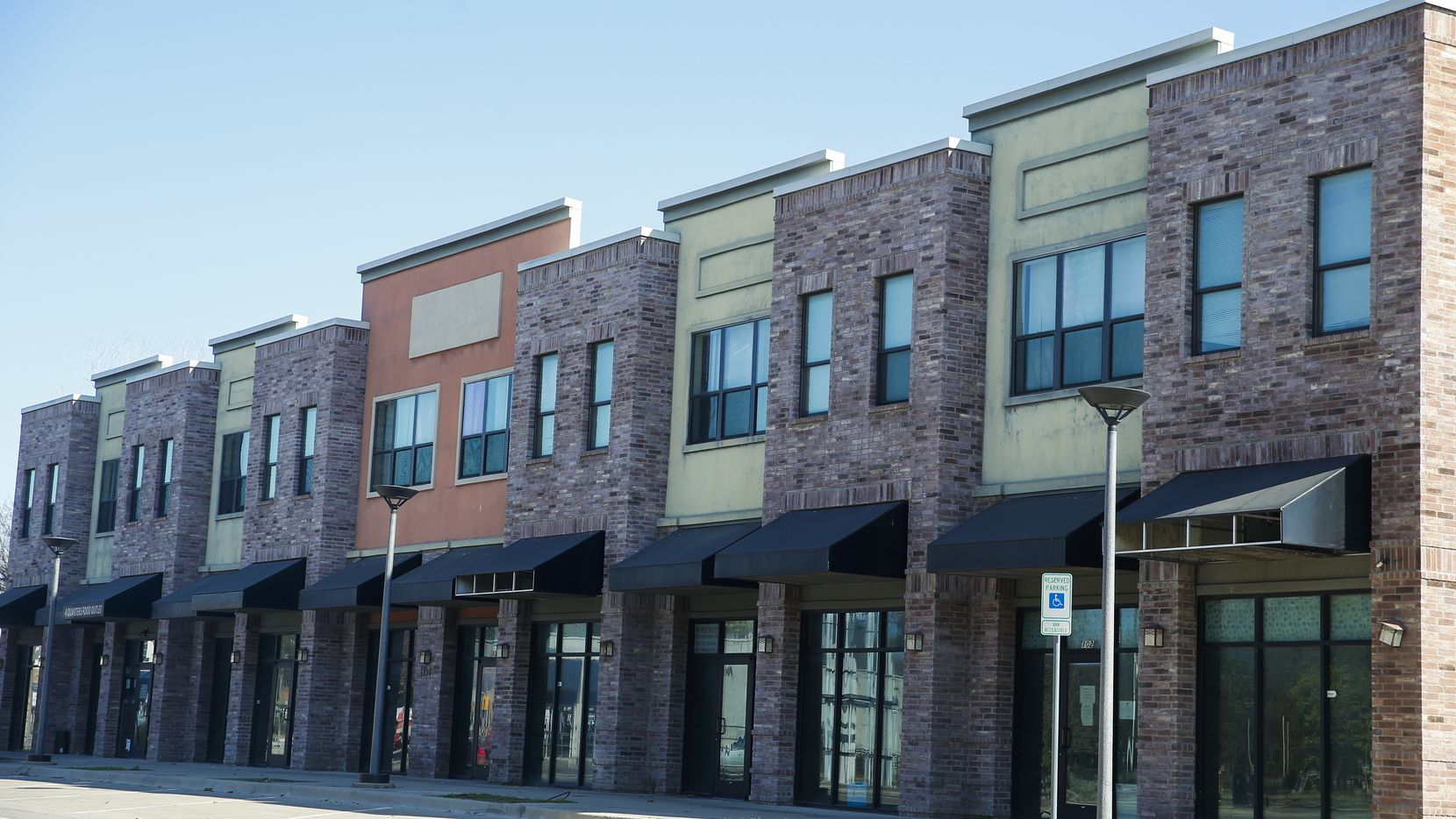 Seven people live in the low-rent upstairs apartments at 5210 Bexar Street. But the downstairs storefronts, which taxpayers helped fund, are barren.