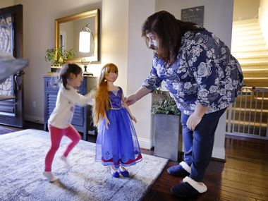"""Carmen Lozoya (right) of Fort Worth plays with granddaughter Esme Bueno Galindo and an Anna doll, based on a princess from the movie """"Frozen."""" Lozoya has an overnight visit from the 3-year-old every weekend."""