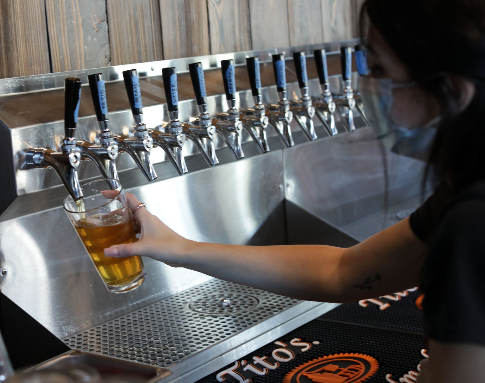 Emily Fuselier pours a pint of Good Intentions beer at Cedar Creek Brewhouse and Eatery in Farmers Branch.