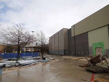 Construction material sit in piles outside the unfinished Cinépolis theater at The Shops at Willow Bend on Friday. Cinépolis has abandoned the project, leaving behind the hulking shell of a multiplex.
