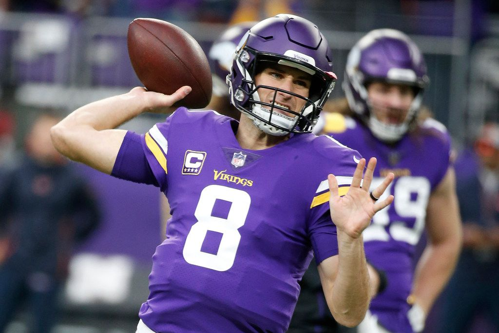FILE - In this Dec. 30, 2018 file photo, Minnesota Vikings quarterback Kirk Cousins warms up before an NFL football game against the Chicago Bears in Minneapolis. Guaranteed payments for unrestricted free-agent contracts this month make up just over half of the total money to be paid, down a bit from 2018, when Kirk Cousins signed a fully guaranteed $84-million deal. (AP Photo/Bruce Kluckhohn, File)