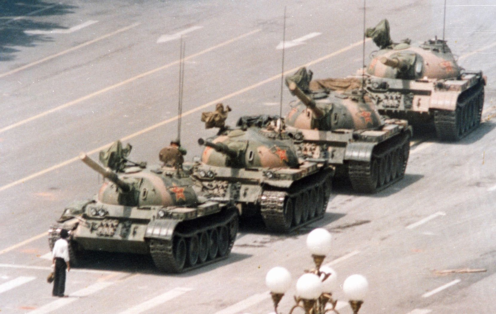 A Chinese man stands in front of a line of tanks in Beijing stopping their advance down Beijing's Cangan Boulevard, near Tiananmen Square, on June 5, 1989, during the crackdown on China's democracy movement.