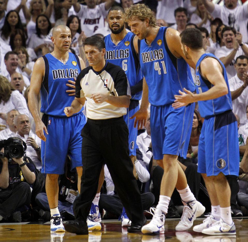 Dallas Mavericks power forward Dirk Nowitzki (41) questions the referee as Dallas Mavericks point guard Jason Kidd (2), Dallas Mavericks center Tyson Chandler (6) and Dallas Mavericks point guard Jose Juan Barea (11) stand by in the first quarter of game six of the NBA Finals between the Miami Heat and the Dallas Mavericks at the American Airlines Arena in Miami, Florida, June 12, 2011. (Tom Fox/The Dallas Morning News)