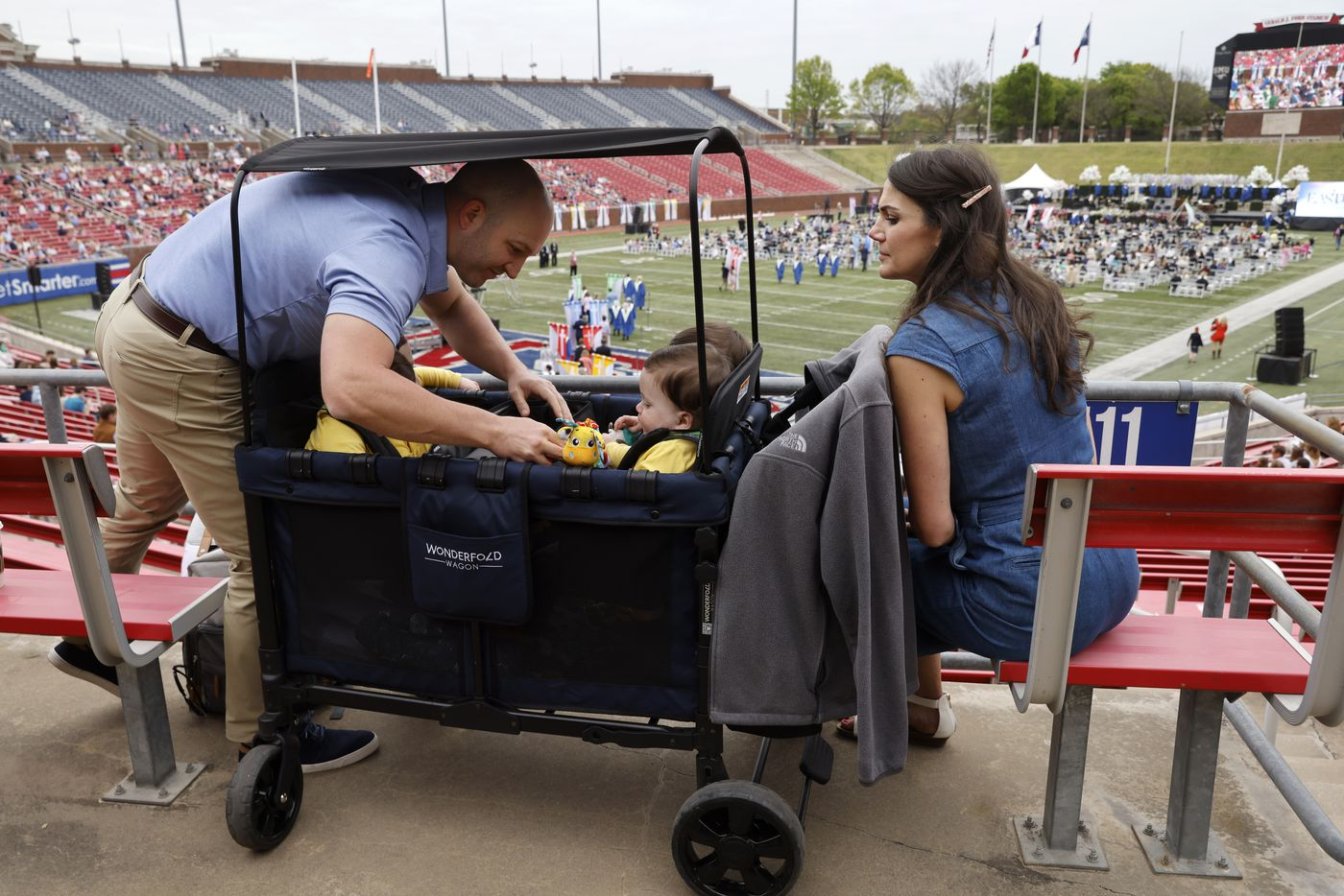 Chris Marr grabs a toy that Hudson Marr dropped in front of Hardy, Harrison and Henry Marr as Jenny Marr looks on during the Highland Park United Methodist Church Easter service held at Gerald J. Ford Stadium on Sunday, April 4, 2021 in Dallas.