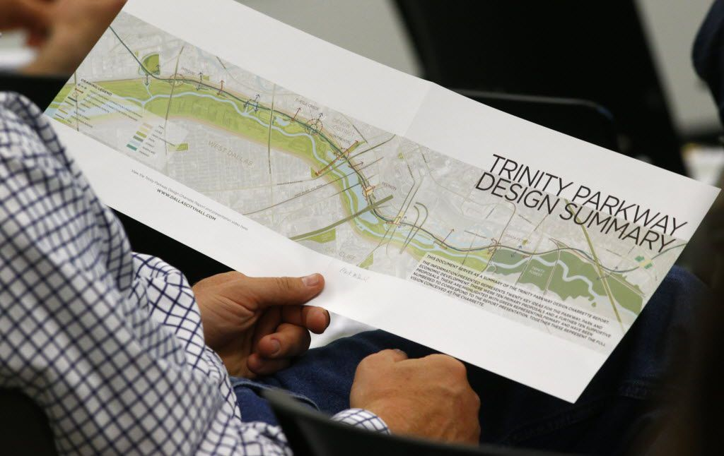 Bill Weinberg looks at a proposal from the Trinity Parkway team of urban experts during a public meeting for the toll road, at El Centro College West Campus in Dallas Tuesday May 26, 2015. (Nathan Hunsinger/The Dallas Morning News)