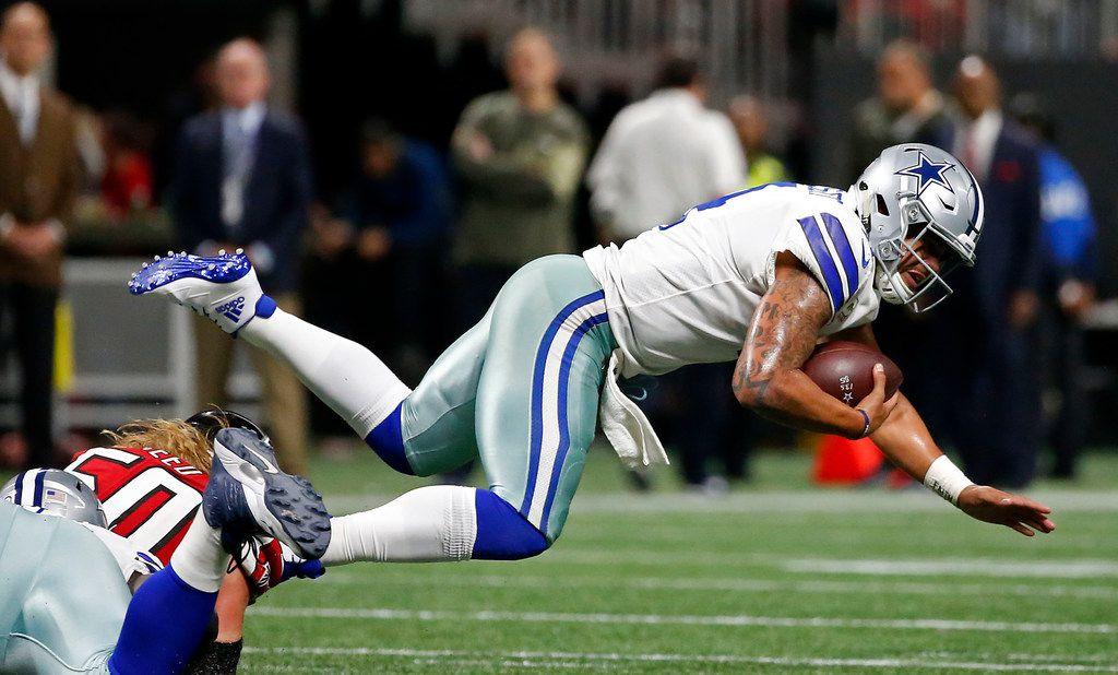 Dallas Cowboys quarterback Dak Prescott (4) is sacked by Atlanta Falcons defensive end Brooks Reed (50) during the fourth quarter at Mercedes-Benz Stadium in Atlanta, Sunday, Nov. 12, 2017. The Cowboys lost 27-7. (Jae S. Lee/The Dallas Morning News)