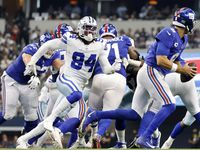 Dallas Cowboys defensive end Randy Gregory (94) chases New York Giants quarterback Daniel Jones (8) from the pocket during the second quarter at AT&T Stadium in Arlington, Texas, Sunday, October 10, 2021.