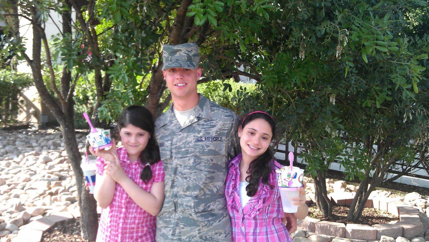 Family photo of Edgar Tirado Jr. with his sisters, Sophia Tirado and Stefania Tirado, on a family visit to his military base.