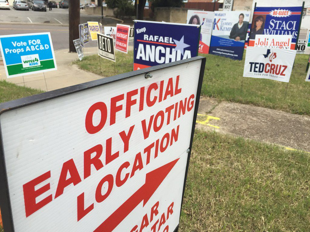 Candidates signs stand near the Dallas County Government Center at the corner of Beckley Ave and Twelfth St, Precinct 5, early Tuesday morning, Oct. 23, 2018 in Oak Cliff. Early voting started Oct. 22 and ends Nov. 2. Polls open at 7 a.m. and close at 7 p.m.Election Day is Nov. 6.
