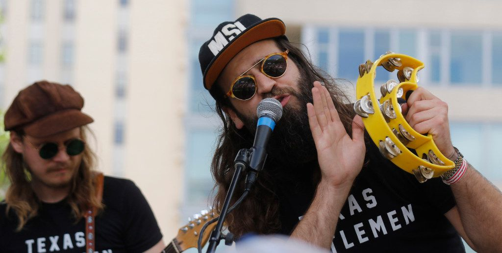 One of the Texas Gentlemen performs with a tambourine at the Old 97's Country Fair held at Main Street Garden in downtown Dallas Saturday April 8, 2017. (Ron Baselice/The Dallas Morning News)
