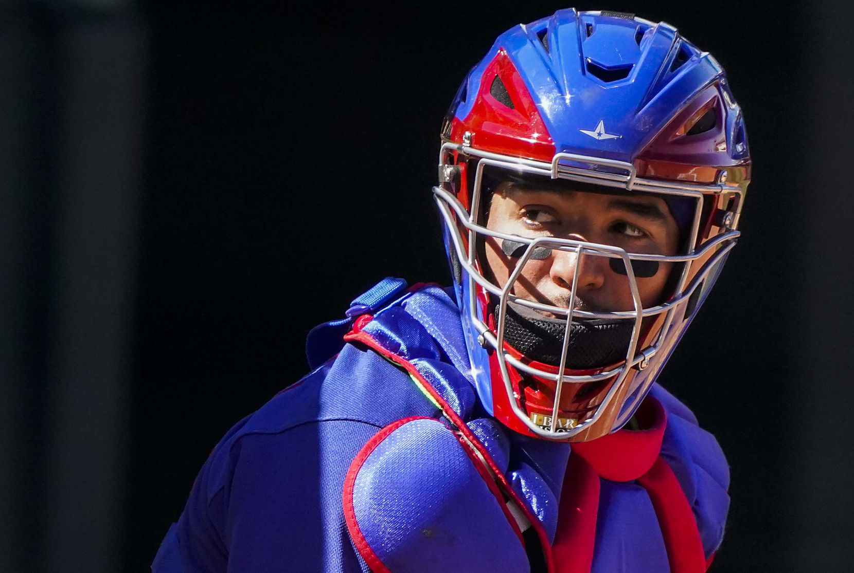 Texas Rangers catcher Jose Trevino looks to the dugout for a sign during the third inning of a spring training game against the San Francisco Giants at Surprise Stadium on Monday, March 1, 2021, in Surprise, Ariz.