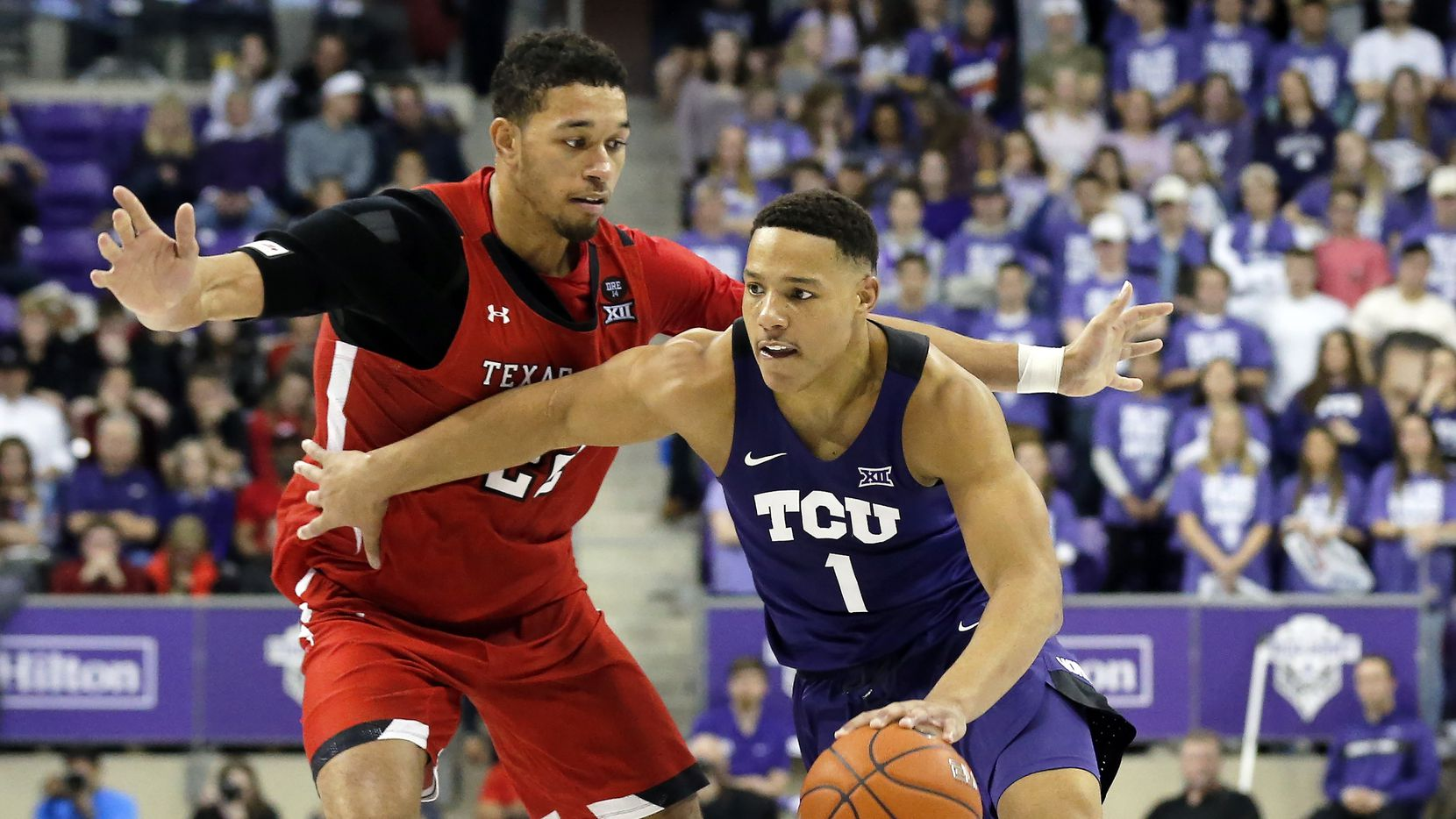 TCU guard Desmond Bane, right, drives to the basket as Texas Tech forward TJ Holyfield, left, defends during the second half of an NCAA college basketball game in Fort Worth, Texas, Tuesday, Jan. 21, 2020. TCU won 65-54.