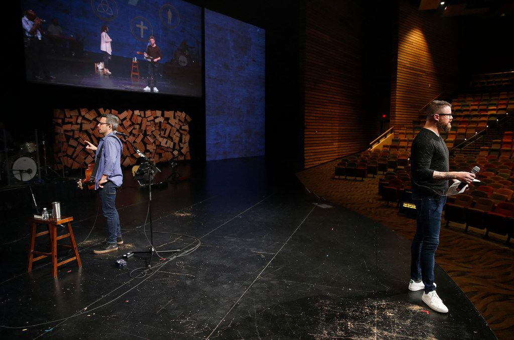 Jon Abel (left), worship director, works with the worship team as Ryan Howell (right), director of technical arts,  goes through the cue-to-cue portion of rehearsal for an upcoming Sunday service at Watermark Community Church.