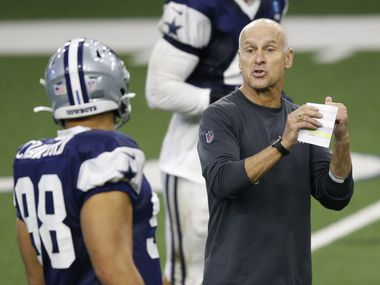 Dallas Cowboys defensive coordinator Mike Nolan talks with Dallas Cowboys defensive end Tyrone Crawford (98) during training camp inside the Ford Center at the Dallas Cowboys headquarters at The Star in Frisco, Texas on Tuesday, August 18, 2020.