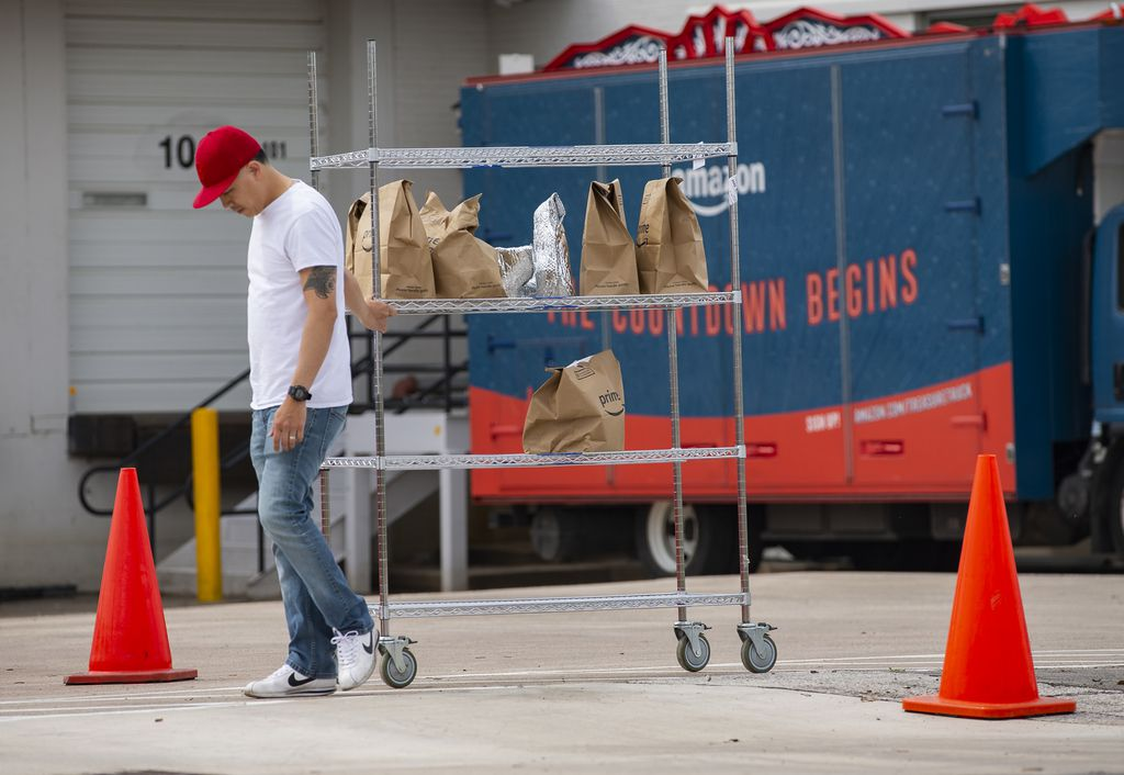 Amazon Prime workers fulfill orders at the Amazon Flex center at 6627 Maple Avenue on Monday.