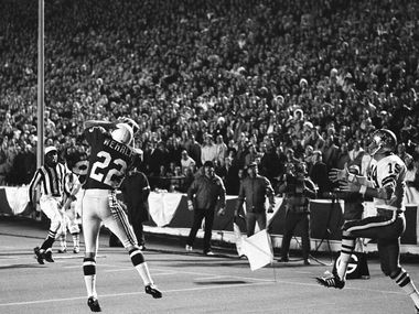 Dallas Cowboys wide receiver Lance Rentzel (19) is left empty handed in the end zone just before the half, as St. Louis Cornerback Roger Wehrli pulls in a pass intended for Rentzel and a Dallas score, Nov. 17, 1970, Dallas, Tex. The Cardinals continued to blank the Cowboys and won, 38-0.