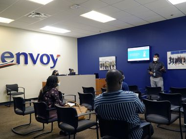 Local 575 Treasurer Abraham Morante speaks with applicants during a job fair at Envoy Airlines in Irving.